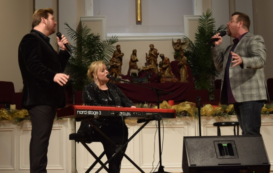 "Jim and Melissa Brady and Steve Ladd sing ""Through It All"" near the end of the annual New Year's Eve concert at Sand Spring Baptist Church."
