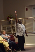 Alonzo Gaines reacts to 'Ragged Old Flag.'