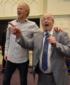 """Jason Clark, left, invites The Noblemen tenor Rob Wagoner to join The Nelons onstage for """"I'll Fly Away."""""""