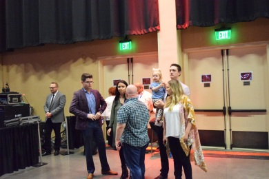 Josh Townsend, of Legacy Five, Katie Erwin and Kody Erwin and his family take in the Goodman Revival.