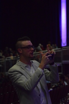 Keith Erwin snaps a photo during the Monday night concert.