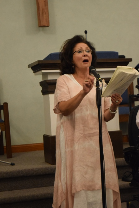 "Allison Speer led the congregation in singing ""In the Sweet, By and By."""
